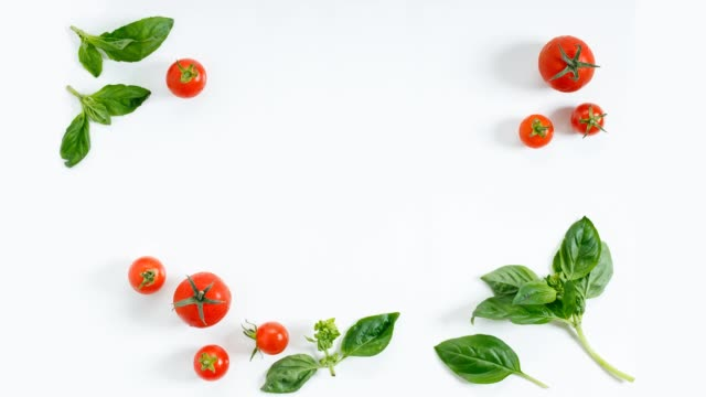 red cherry tomato on white background with copyspace
