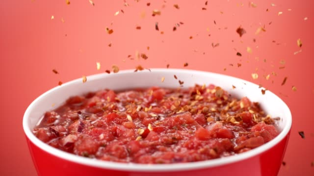 Red chili pepper spice falling into hot mexican sauce. Mexican cuisine. Super slow motion studio shot with robotic motion control system. Phantom flex4k chili pepper stock videos & royalty-free footage