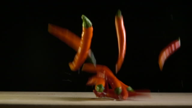 Red chilli falling down slow motion video