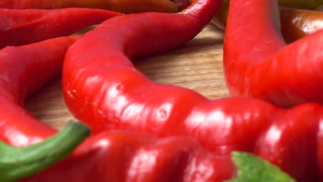 Red chilli, pepper. Shooting in the movement.