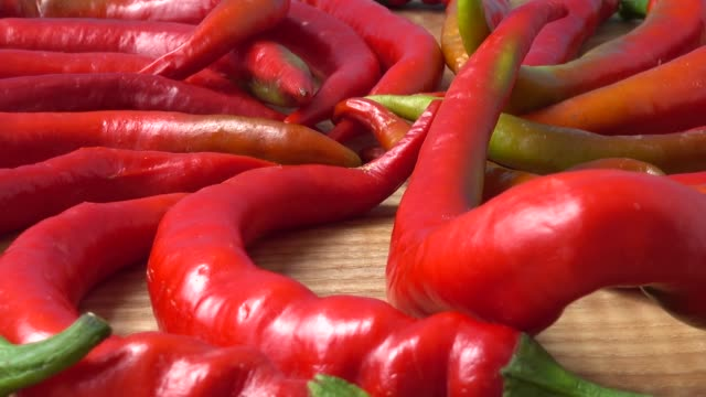 Red chilli, pepper.Shooting in the movement.