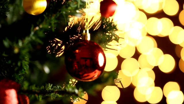 Red Christmas Balls on Christmas Tree Red Christmas Balls on Christmas Tree with light bokeh on background holiday stock videos & royalty-free footage