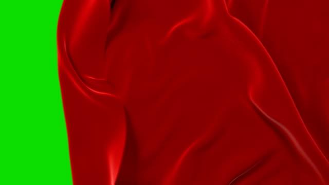 röd trasa flytta bort viftande och öppna bakgrund. abstrakt tyg över gång 3d-animering med alpha mask grön skärm. - red silk bildbanksvideor och videomaterial från bakom kulisserna