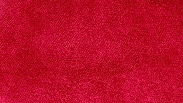 Bидео red cloth texture background rotate