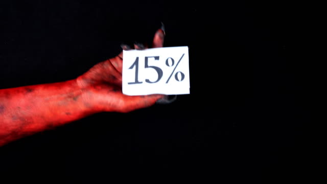 Red demon hand holding sale card 15 percentage 50 fps video