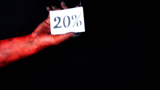 Red demon hand holding sale card 20 percentage 50 fps video