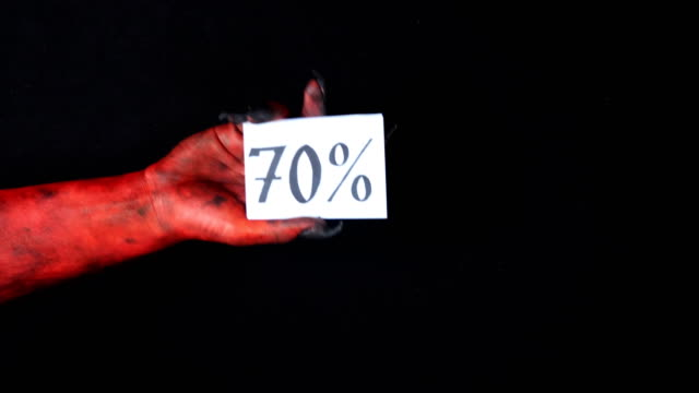 Red demon hand holding sale card 70 percentage 50 fps video