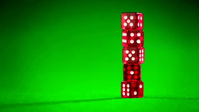 red dices on green cloth... video
