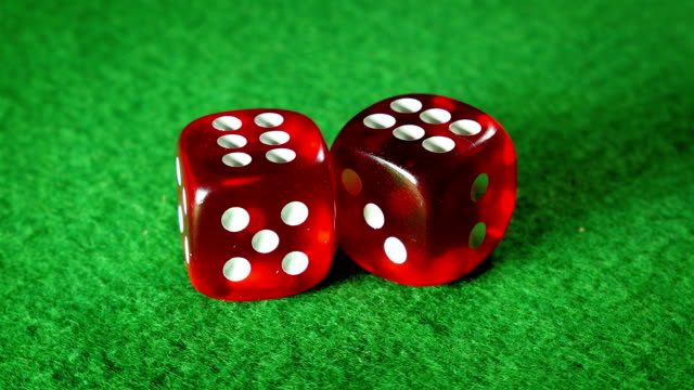 Red dices on the green cloth background. Rotation. Double six. video