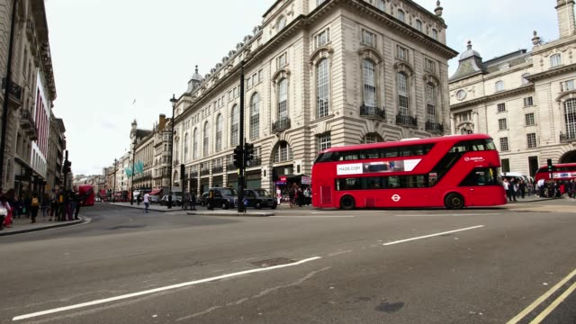 red double decker bus passing by piccadilly circus in london, great britain - england stock videos & royalty-free footage