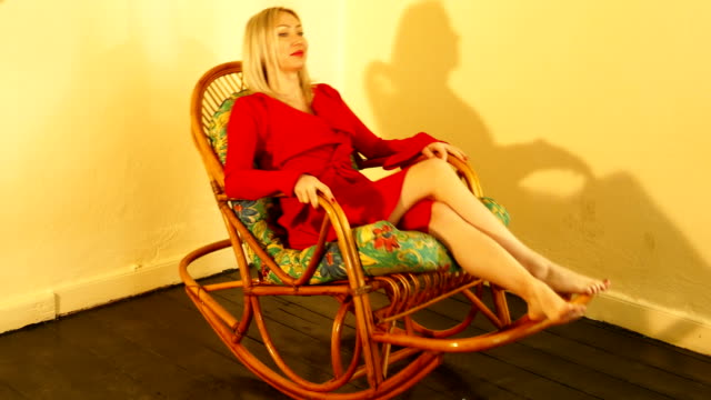 red dresses woman with rocking chair red dresses woman with rocking chair with rocking shadow cross legged stock videos & royalty-free footage