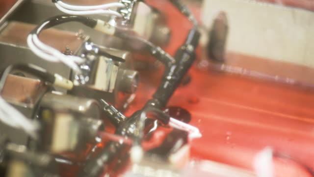 red engine oil inside machine. oil drops spills. - lega metallica video stock e b–roll