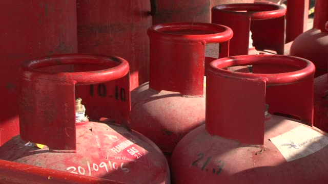 red gas cylinders - cilindro video stock e b–roll