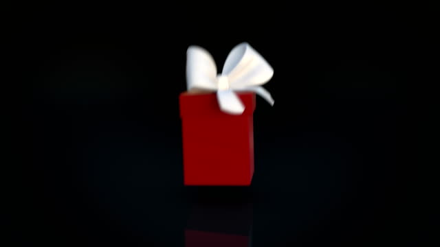 vídeos de stock e filmes b-roll de red gift box opening animation and zoom in camera action - gift box