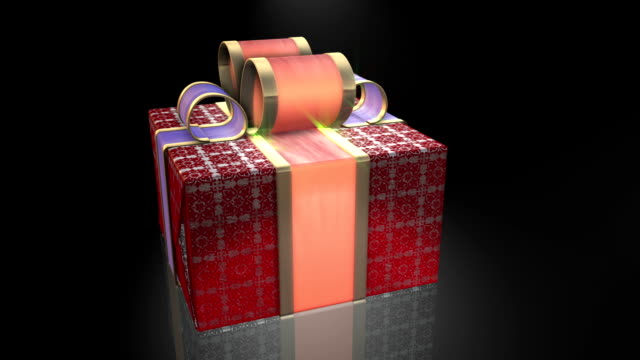 Red gifts on black background. video