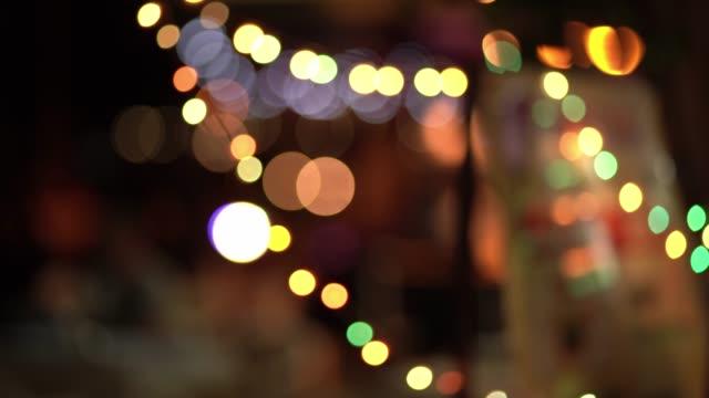 kırmızı glitter vintage ışıklar arka plan. defocused - bling bling stok videoları ve detay görüntü çekimi
