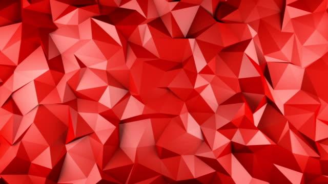 赤い光沢のある多角形幾何学的表面シームレス ループ - ローポリモデリング点の映像素材/bロール