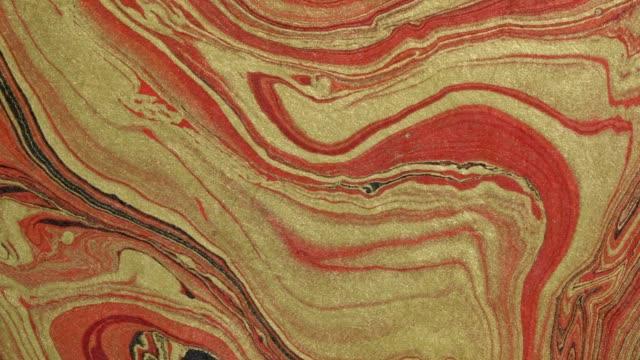 rött, guld och svart vågor och virvlar - marble bildbanksvideor och videomaterial från bakom kulisserna
