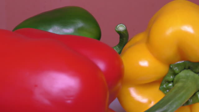 vídeos de stock e filmes b-roll de red, green and yellow paprika – close up, detail, macro - red bell pepper isolated