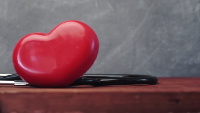 Red heart and stethoscope on red table, world health day and healthcare concept. Red heart and stethoscope on red table, world health day and healthcare concept. world health day stock videos & royalty-free footage