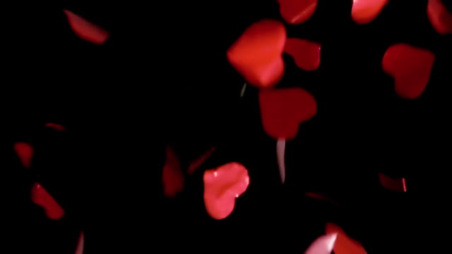 HD - Red Hearts Confetti. Red pieces slowly fall down HD - Red Hearts Confetti. Red pieces slowly fall down pyrotechnic effects stock videos & royalty-free footage