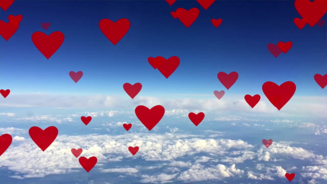 Red hearts rising up on background blue sky with white clouds animation card Seamless loop. video