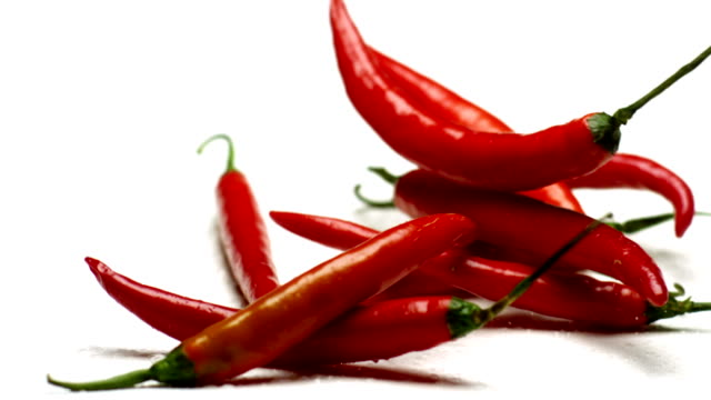 Red hot chilli in super slow motion on white background video
