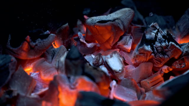 Red hot coals Burning charcoal.Hot coals in the fire.Fire woods and hot coal in a grill.The brazier of hot coals.Bright red hot charcoal.4K video,4K. coal stock videos & royalty-free footage
