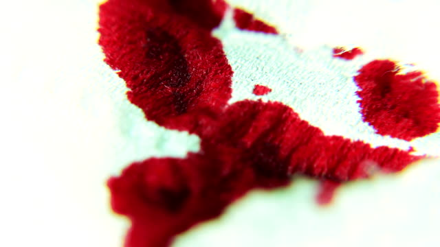 Red Ink / Blood absorbing into a Bandage MACRO Red ink or blood is dripping and absorbing into a bandage Macro Shot and detailed shot of blood / ink absorbing into a porous bandage medevac stock videos & royalty-free footage
