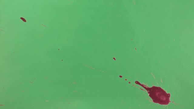 Red Ink Splatter Over Green Screen Background video