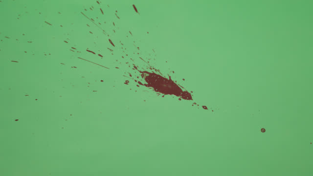 Red Ink Splatter Over Green Screen Background видео