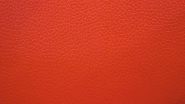 röd läder bakgrund skott på smartphone - läder bildbanksvideor och videomaterial från bakom kulisserna