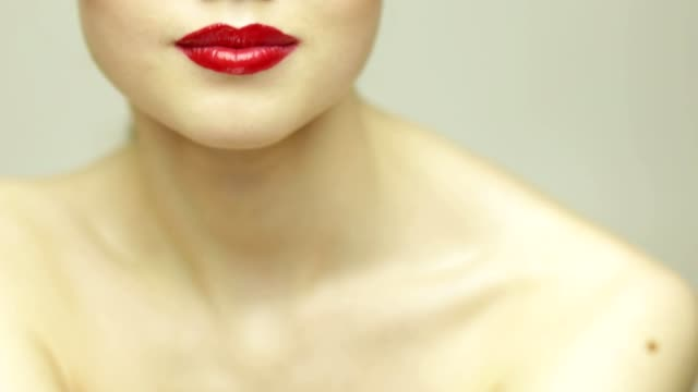 Red lips fashion girl Young fashionable woman with red lips posing on white in slow motion. Shallow depth of field. High key human lips stock videos & royalty-free footage