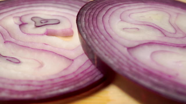 Red onion rings on a wooden cutting board, close up Red onion rings on a wooden cutting board, close up clip red onions stock videos & royalty-free footage
