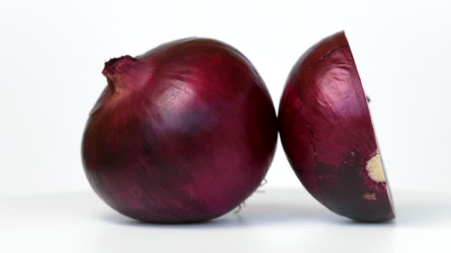 Red onion rotating on white background Red onion rotating on white background red onions stock videos & royalty-free footage