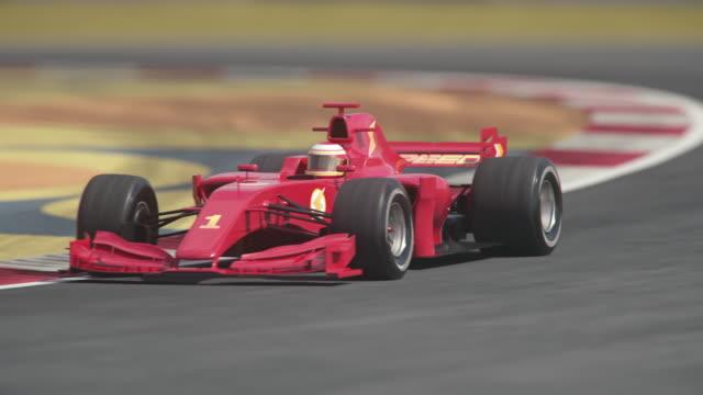 헤어 핀 곡선을 통해 운전 하는 레드 포뮬러 1 경주 용 자동차 - formula 1 스톡 비디오 및 b-롤 화면