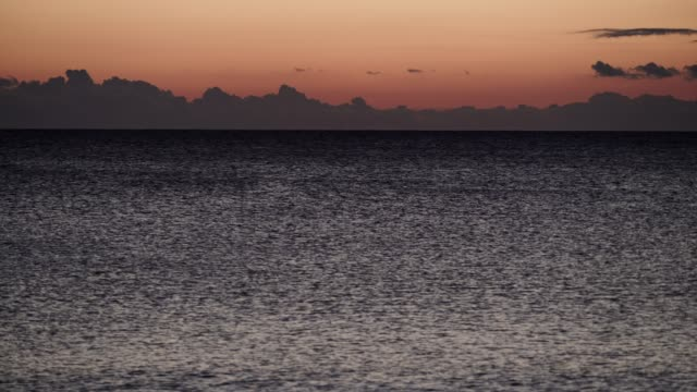 red orange sky after sunset over sea surface, timelapse - пелопоннес стоковые видео и кадры b-roll