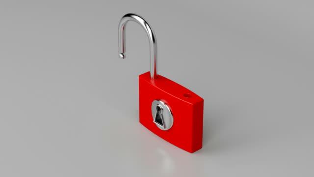 Red padlock Red padlock on gray background, unlocking and locking padlock stock videos & royalty-free footage