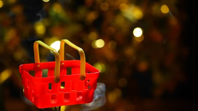 red plastic basket smoke nobody gold bokeh