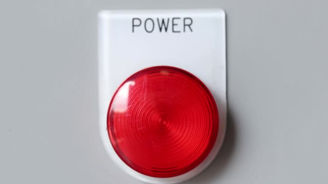 red power button and the light is on to start machine close-up of red power button and the light is on to start machine push button stock videos & royalty-free footage