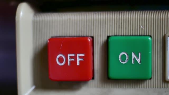 red power button on black background - zasilanie elektryczne filmów i materiałów b-roll