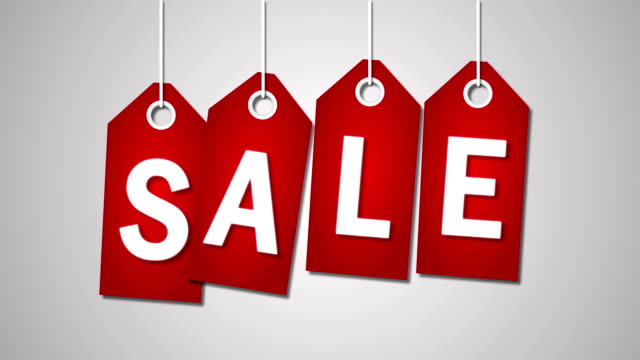 Red price tags with Sale and fifty percent off on the white background video