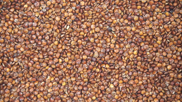Red quinoa seeds as background