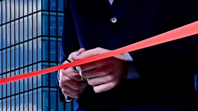 red ribbon cutting - ribbon stok videoları ve detay görüntü çekimi