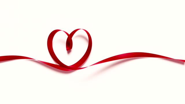 Red Ribbon Forming A Heart Shape On White Background 4K Resolution Red ribbon forming a heart shape on white background. 4K resolution. Alpha matte is included at the end of the clip. valentines day stock videos & royalty-free footage