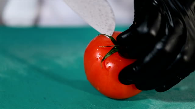 Red ripe tomato cut in half by the chef's culinary knife A tomato is chopped in half on a cutting board tomato salad stock videos & royalty-free footage