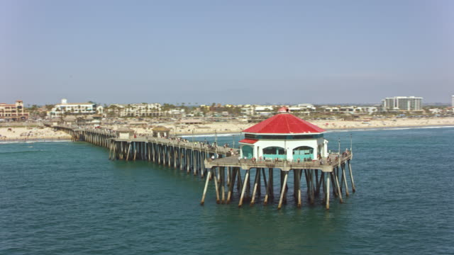 AERIAL Red roof diner on the pier of the Huntington beach