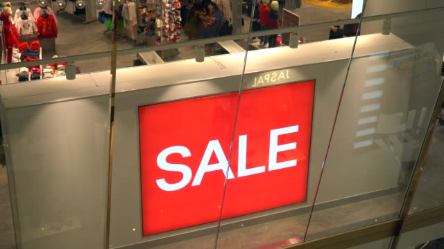 red sale sign in crowded shopping mall - bankruptcy stock videos and b-roll footage