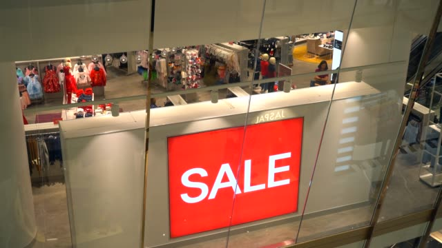 red sale sign in crowded shopping mall - sales video stock e b–roll