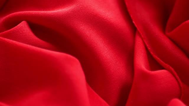 röd satin tyg bakgrund slowmotion - red silk bildbanksvideor och videomaterial från bakom kulisserna